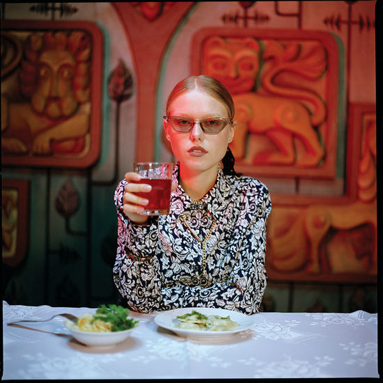 Portrait of a young woman drinking glass
