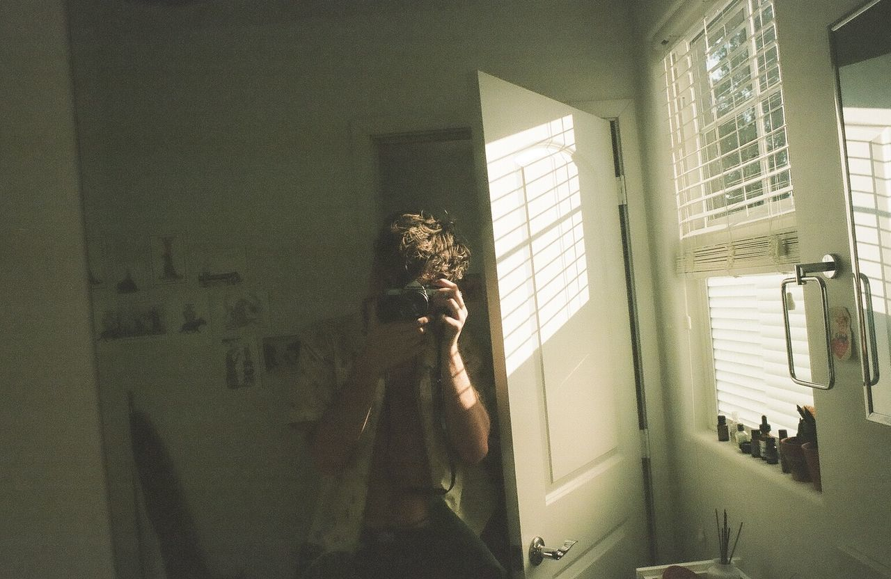 MAN STANDING IN BATHROOM