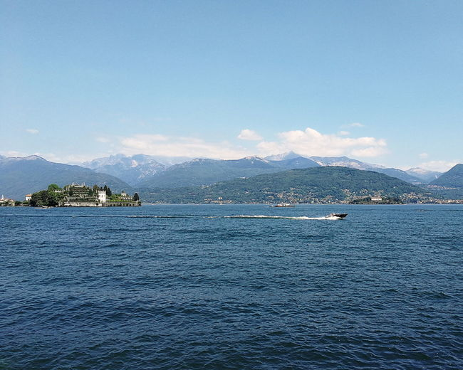 Blue Sky No People Outdoors Water Nature Day Beauty In Nature Reflections Postcard Keep Calm POV Panorama Lago Maggiore Maggiore Lake Vacations Mountain Boat Isola Bella Speed Velocity Piedmont