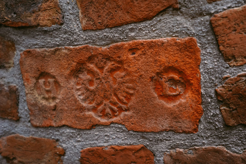 A brick with the coat of arms of Austria Austria Brick Wall Cityscape Eagle Europe Trip Sightseeing Tourist Attraction  Travel Vienna Brick Coat Of Arms Engraved Europe Landmark Tourism Tourist Destination Wien