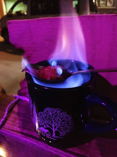 Feuerzangenbowle Germany Sugar And Rum Rum Sugar Pink Christmas Market Christmas Lights Feuerzangenbowle Mulled Wine No People Purple Burning Indoors  Food And Drink Night Close-up Food Illuminated Freshness