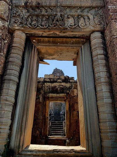 Angkor Churning Of The Water Carvings Series Doorways Doorway Angkorarcheologicalpark East Mebon Architecture Built Structure Building Exterior No People History The Past Day Travel Destinations Arch Travel Building