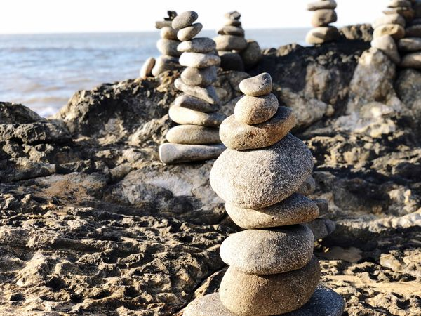 Balancing Rocks Balancing Rock Stack Beach Sea Land Rock Nature Solid Balance Sunlight No People Zen-like Rock - Object Stone - Object Tranquility Day Focus On Foreground Water Sand Outdoors Sky