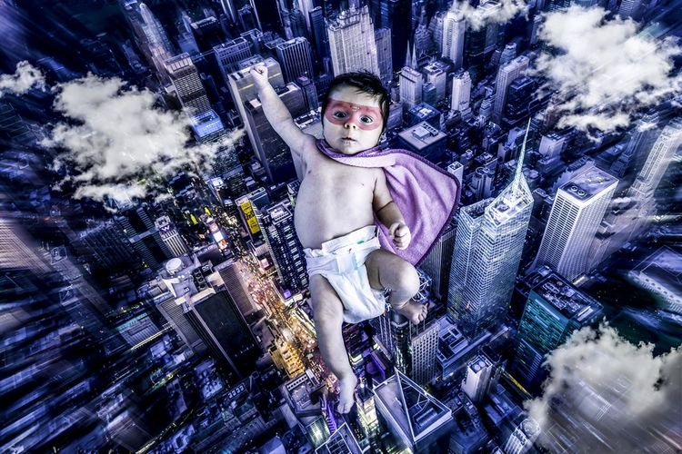 Here we go! A New Beginning Baby Superhero Flying Portrait Looking At Camera Night Cityscape Real People Skyscraper