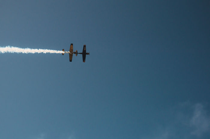Airplane Airshow Day Flying Low Angle View Nature No People Outdoors Red Bull Air Race Red Bull Air Show Sky Teamwork Vapor Trail