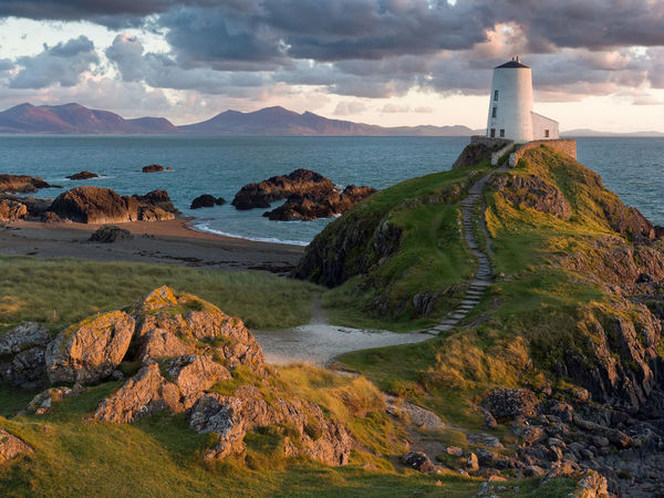 Llanddwyn Island, Anglesey Dream House Evening Light Film Location Lighthouse Llyn Peninsula Newborough Wales UK Newborough Beach Peace And Quiet Sea Scapes Winding Path Anglesey Beach Evening Sky Golden Hour Half Light Landscape Llanddwyn Island Peaceful Rocks Sea And Sky Seascape Tranquil Scene Warm Colors Warm Glow Winding Stairs