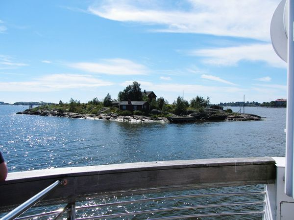 Island Sea Helsinki seen from the Ferry Boat Summer Sunny Day Rocks Glacial Rocks House Sea And Sky Colour Of Life