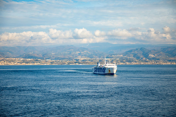 Messina Italy Sicily Ferry Sea Nautical Vessel Water Transportation Mode Of Transportation Cloud - Sky Sky Sailing Waterfront Travel Nature Ship No People Beauty In Nature Scenics - Nature Day Outdoors Motion Craft Passenger Craft Cruise Ship Sailboat