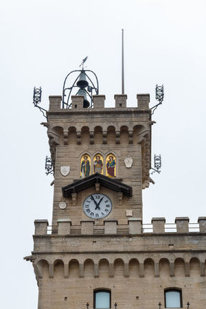 Detail of the town hall in the square Palazzo Pubblico in San Marino Palazzo Pubblico Rathaus San Marino Architecture Building Building Exterior Built Structure City Clear Sky Clock Clock Face Clock Tower Day History Low Angle View Minute Hand Nature Old Outdoors Regierung Sky The Past Time Tower Uhrturm