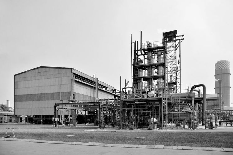 Low angle view of factory against sky