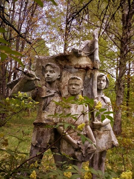 Pioneers in the forest Architecture Tree Low Angle View Statue Sculpture Day No People Growth Outdoors Built Structure Nature Sky The Architect - 2017 EyeEm Awards