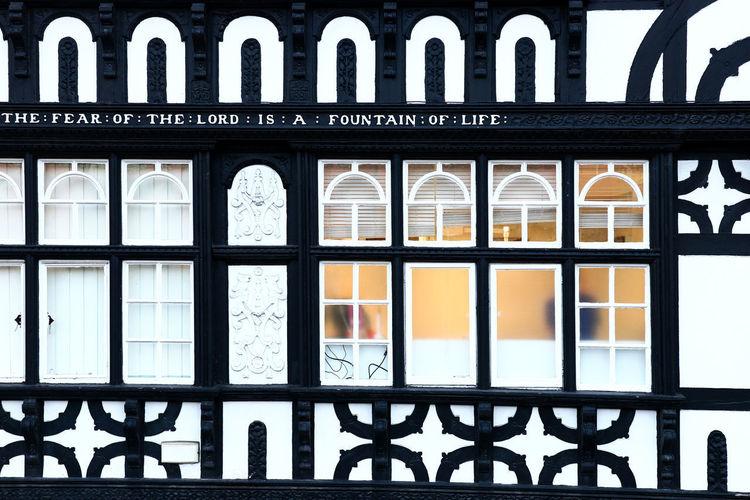 Building seen through metal grate window
