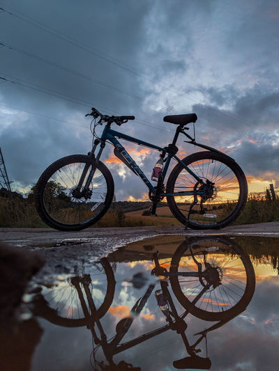Low angle view of bicycle parked against sky