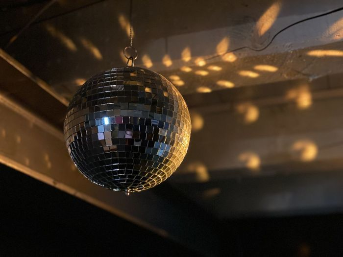 Low angle view of disco ball hanging on ceiling