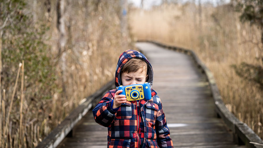 A boy captures a picture.