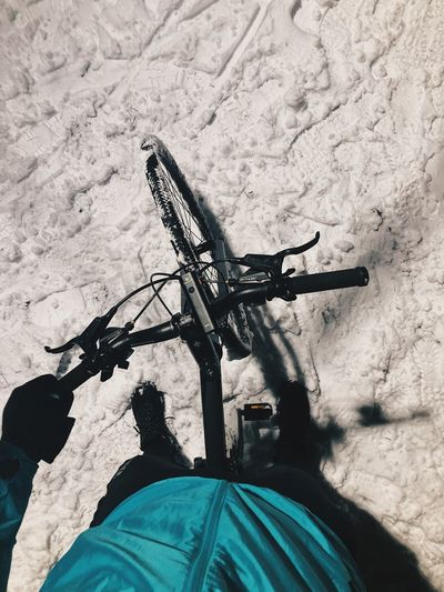 High angle view of man riding bicycle on snow