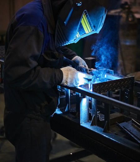 Side view of man working in workshop