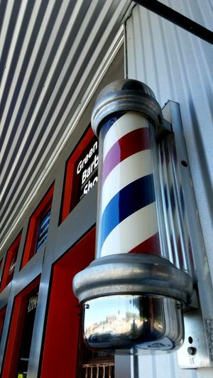 Barber Shop Low Angle View Red Pattern Architecture Building Exterior The Street Photographer - 2017 EyeEm Awards The Architect - 2017 EyeEm Awards Artistic Barber Pole Striped Blue Copy Space Red White Angle Architecture Freshness Fun Street