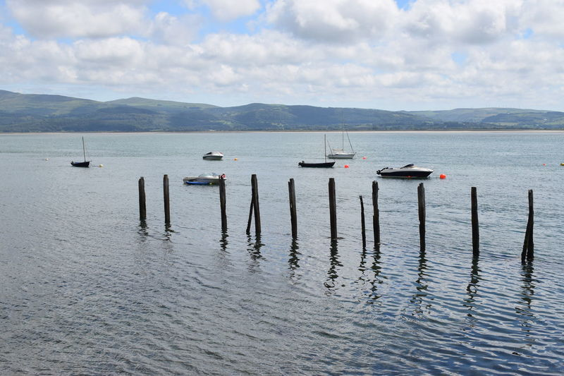 Aberdovey boats Water Mountain Nautical Vessel Cloud - Sky Transportation Tranquil Scene Sky Mode Of Transportation Tranquility Day Scenics - Nature Beauty In Nature Nature No People Waterfront Mountain Range Lake Outdoors Post Wooden Post Floating On Water Estuary Aberdovey Wales UK Moored