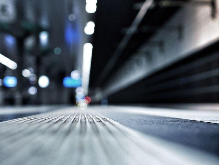Surface Level Of Illuminated Railroad Station Platform