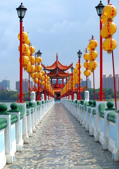 The Five Li Pavilion is a popular tourist attraction in the Lotus Lake in Kaohsiung, Taiwan Bridge Causeway Chinese Architecture Chinese Culture Kaohsiung Lake Lampions Lanterns Lotus Lake Pavilion Perspective