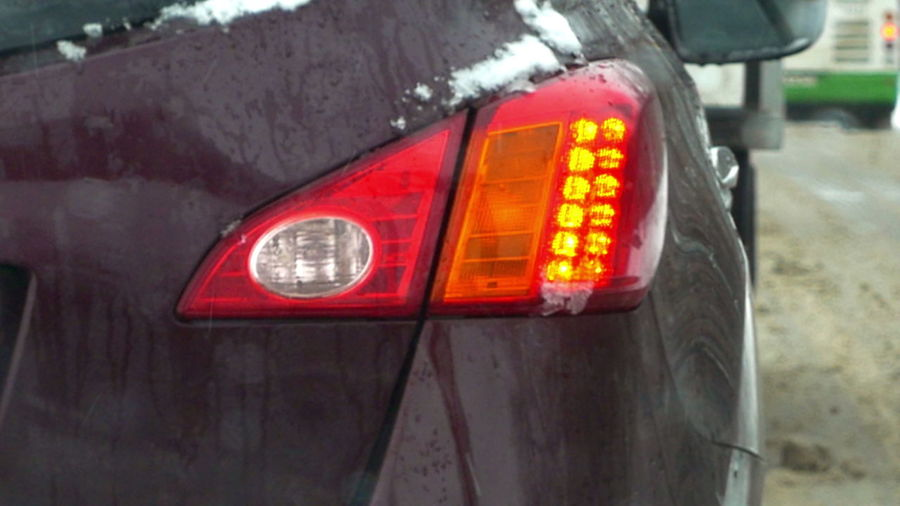 Close-up of illuminated red car in city