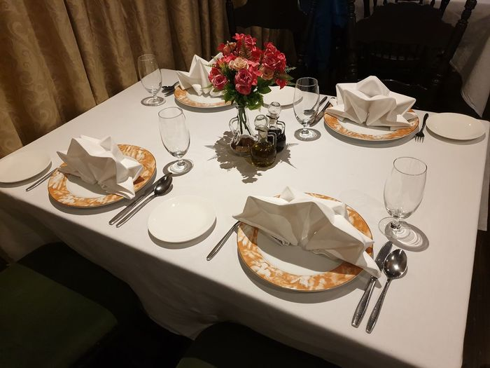 Tablesetting is a kind of art. Napkins NapkinFolding Napkinart Tablesetting Restaurant Restaurant Table Diner Table EyeEm Selects Luxury Table Flower Tablecloth Plate Place Setting Silverware  Cutlery Eating Utensil Fine Dining Napkin Dining Setting The Table Empty Plate Table Knife Fork