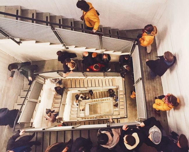 High Angle View Of People Walking On Spiral Staircase