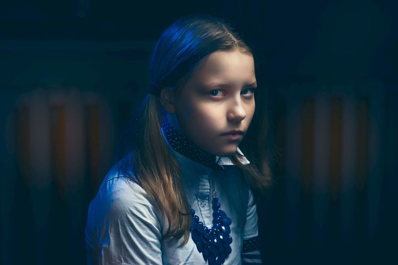 Adult Beautiful Woman Beauty Blue Childhood Children Only Close-up Focus On Foreground Headshot Illuminated Long Hair Medium-length Hair Night One Girl Only One Person Outdoors People Portrait Standing Young Adult