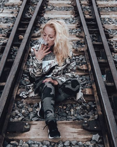 Long Hair Blond Hair One Person Sitting Railroad Track One Woman Only Only Women Adults Only Adult People Day Outdoors Women Full Length Young Adult Human Body Part One Young Woman Only The Portraitist - 2017 EyeEm Awards