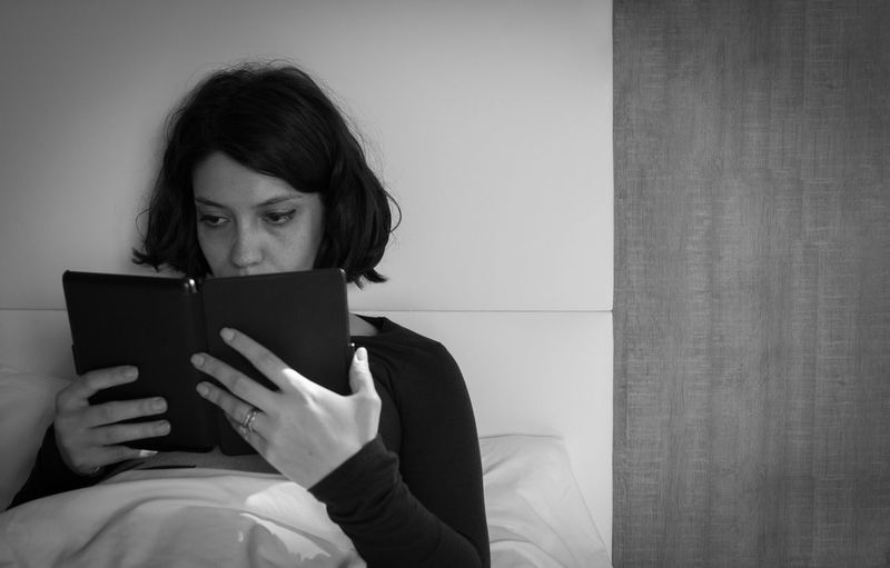 Young woman using digital tablet at home
