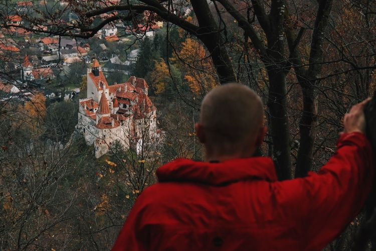 Rear View Of Man Looking At Bran Castle