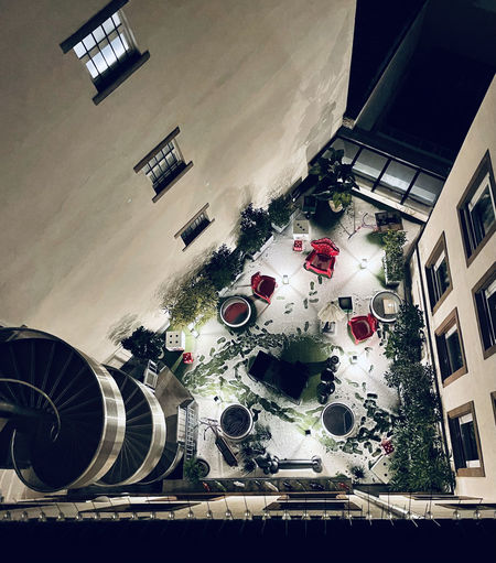 High angle view of illuminated building in city
