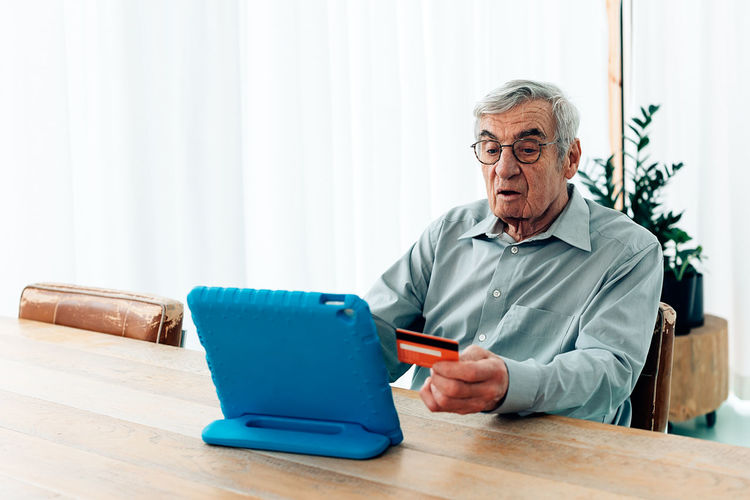 Man sitting on table at home