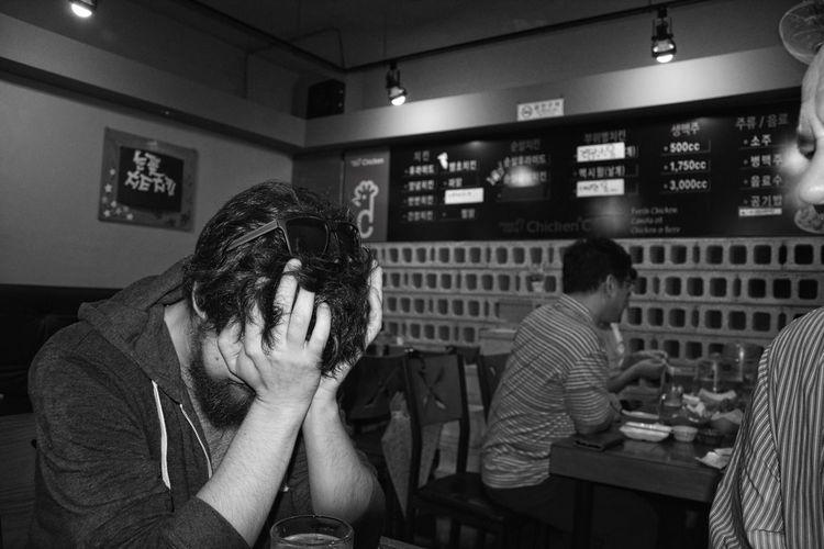 Men sitting in restaurant