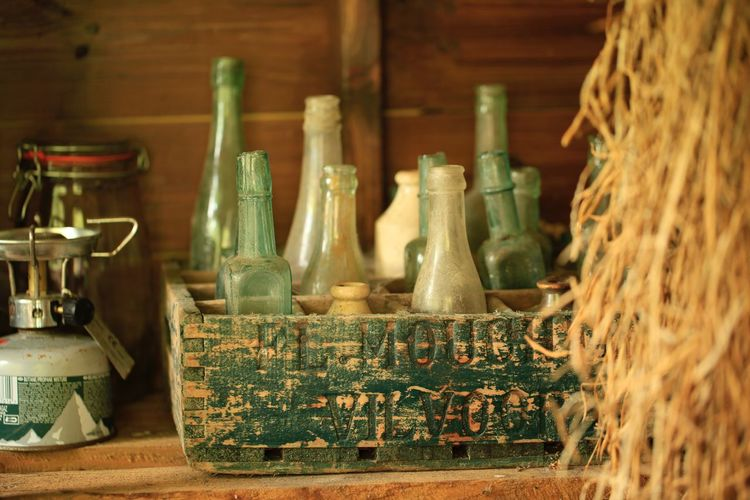 Old Bottles In A Wooden Box