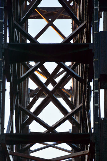 Alloy Architectural Feature Architecture Bridge Building Built Structure Close-up Connection Day Directly Below Full Frame Girder Industry Low Angle View Metal Nature No People Outdoors Pattern Sky Steel Wood - Material