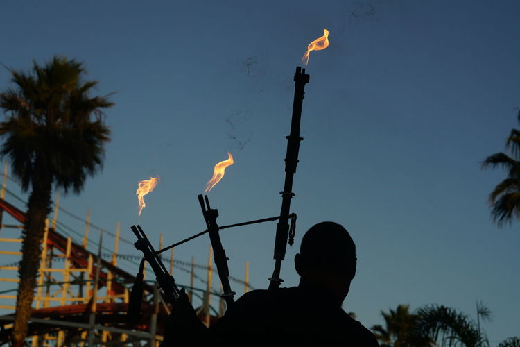 Flame Fuel Hot Silhouette Bagpipe Bagpiper Flame Dusk Fire Flame Flameing Fuel And Power Generation Fırın Hotness Low Angle View Men One Person Outdoors People Propane Real People Sihouette  Silhouette Silhouette Musician Sky Warm