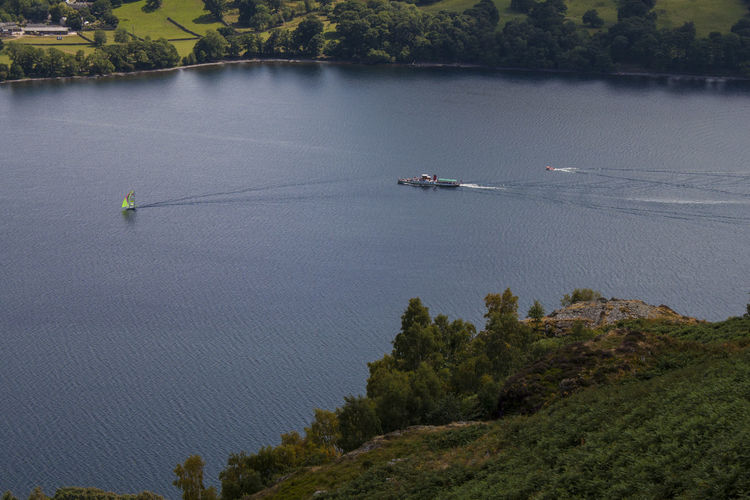 Not really racing Lake District Beauty In Nature Day High Angle View Lake Leisure Activity Mode Of Transportation Nature Nautical Vessel Non-urban Scene Outdoors Plant Real People Scenics - Nature Tranquil Scene Tranquility Transportation Travel Tree Ullswater Steamer Ullswater, Lake District, Water The Traveler - 2018 EyeEm Awards