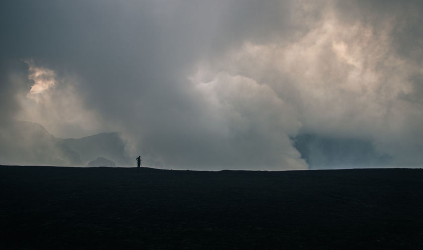 Beauty In Nature Cloud - Sky Day Field Forked Lightning Full Length Landscape Lightning Nature One Man Only One Person Outdoors People Power In Nature Real People Scenics Silhouette Sky Storm Cloud Thunderstorm Tranquility Weather