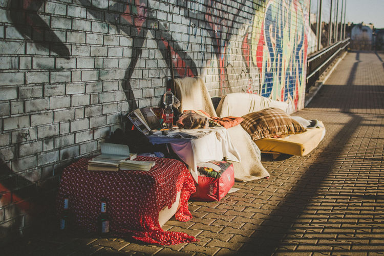 One Person Real People Relaxation Full Length Women Lifestyles Adult Architecture Sleeping Built Structure Wall Clothing Day Resting Lying Down Wall - Building Feature Leisure Activity Casual Clothing Sitting Brick