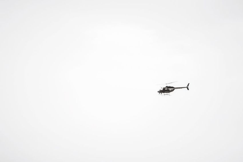 Helicopters In The Sky Helicopter In Action Helicopter Photography Copy Space Air Vehicle Low Angle View Transportation Mode Of Transportation No People Helicopter Mid-air Flying on the move White Color Clear Sky