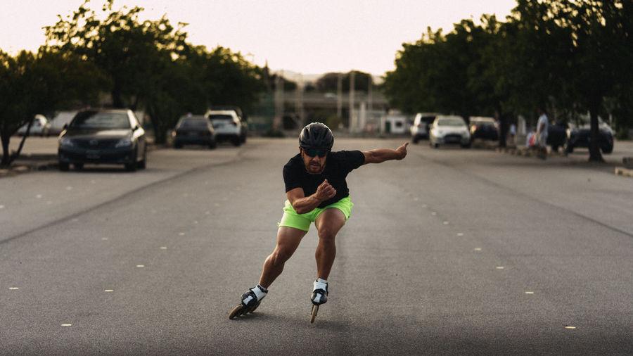 Full length of man running on road in city