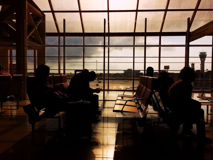 High Contrast Waiting Room Airport Waiting Airport Terminal Indoors  Sitting Window Men Silhouette Chair Table Real People Architecture People