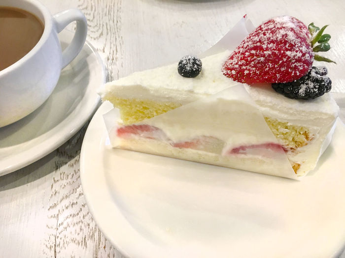 Strawberry creme cake Berry Fruit Cake Close-up Coffee Day Dessert Food Food And Drink Freshness Fruit Indoors  Indulgence No People Plate Ready-to-eat Serving Size SLICE Still Life Strawberry Sweet Food Table Temptation Unhealthy Eating