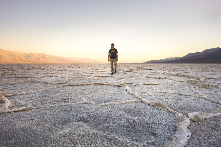 Adult Arid Climate Beauty In Nature Climate Day Desert Environment Full Length Land Landscape Men Mineral Mountain Nature One Person Outdoors Salt Flat Scenics - Nature Sky Standing Tranquil Scene Tranquility Summer Exploratorium