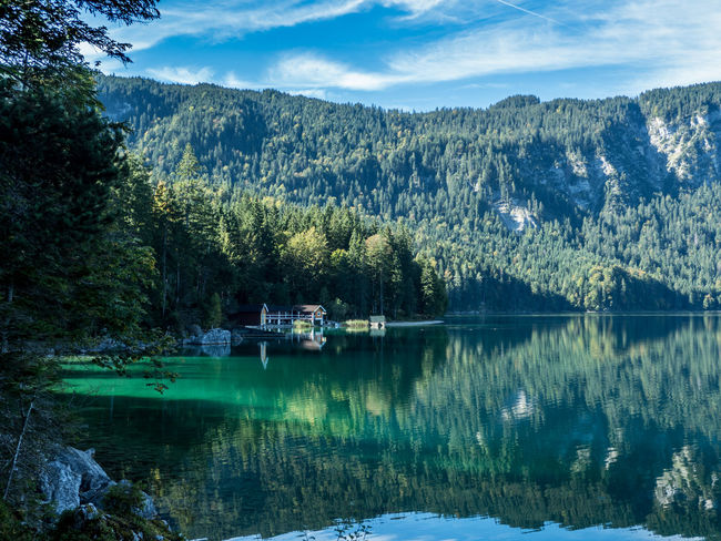 Eibsee Bavaria Germany Bavaria Eibsee Garmisch Zugspitze Beauty In Nature Cold Temperature Day Forest Garmischpartenkirchen Germany Green Color Lake Mountain Mountain Range Nature No People Outdoors Reflection Scenics Sky Tranquil Scene Tranquility Tree Water Waterfront