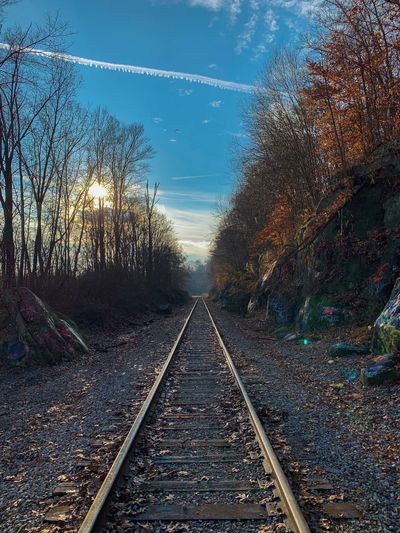 Forward thinking! Sky Graffiti Adventure Ohio Hiking Outdoors Forward Thinking Track Railroad Track Rail Transportation Sky Transportation Diminishing Perspective vanishing point Nature No People The Way Forward Direction Plant Tree Straight Day Outdoors Cloud - Sky Mode Of Transportation Long