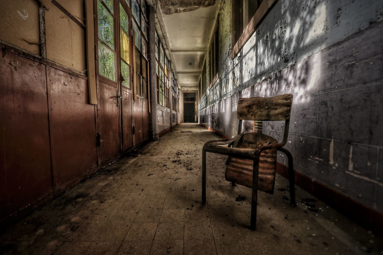architecture, abandoned, absence, indoors, old, wall - building feature, punishment, building, empty, no people, wall, obsolete, run-down, seat, prison, built structure, decline, damaged, weathered, prison cell, deterioration, dirty, flooring, ruined