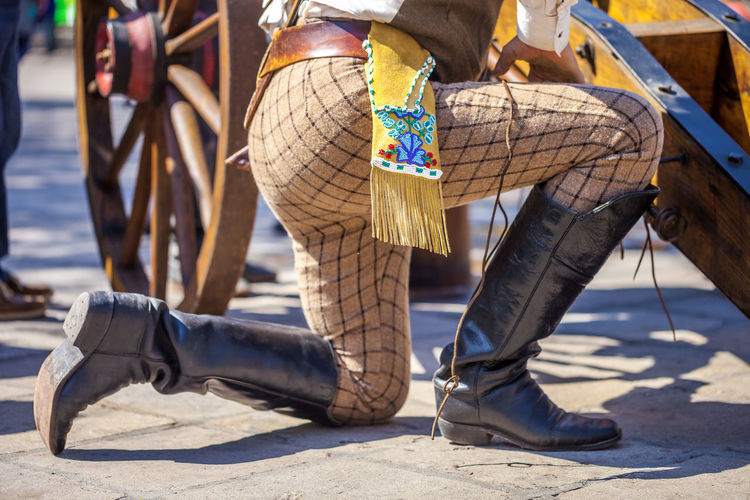 Man wearing 19th century soldier uniform with beautiful embroidery 19th Century Boots Celebration Leather Remember The Alamo Soldier Belt  Costume Culture Day Embroidery Festival Focus On Foreground Human Leg Kneeling Down Lifestyles Low Section Men One Person Outdoors Real People Shadow Street Unifrom